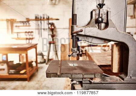 Well-used jig saw machine in a woodwork workshop
