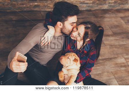 Happy Couple With Shar Pei Puppy Taking Selfie
