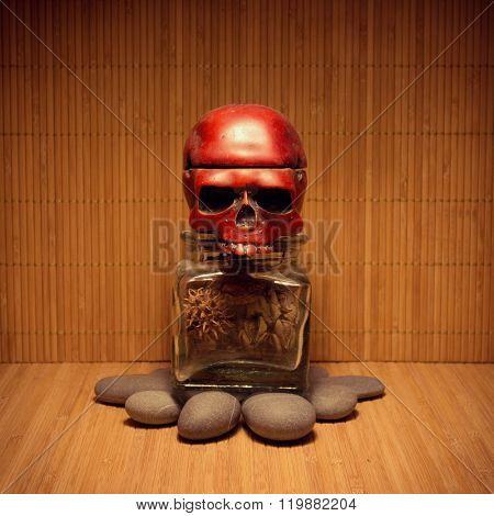 Allegory tomb monument with skull head and dry floral parts as internal organs inside of a jar