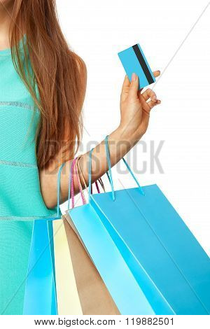 Closeup Of Womans Hand With Shopping Bags And Credit Card.