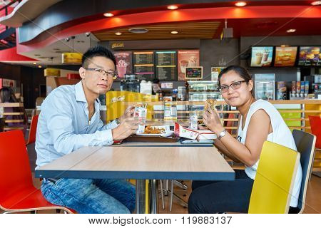 PATTAYA, THAILAND - FEBRUARY 25, 2016: people eat at McDonald's restaurant. McDonald's is the world's largest chain of hamburger fast food restaurants.