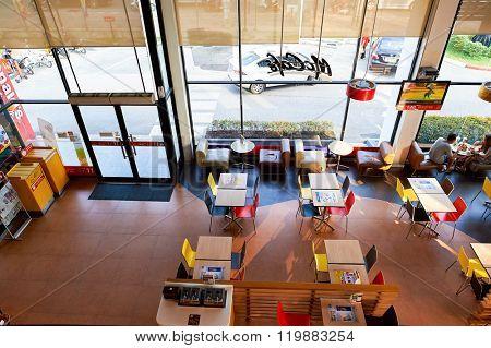 PATTAYA, THAILAND - FEBRUARY 21, 2016: inside of McDonald's restaurant. McDonald's primarily sells hamburgers, cheeseburgers, chicken, french fries, breakfast items, soft drinks, milkshakes, desserts