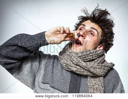 Man Using Nose Spray
