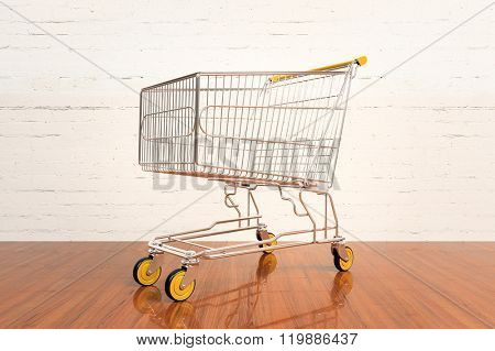 Empty shopping cart  on hardwood floor