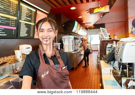 PATTAYA, THAILAND - FEBRUARY 21, 2016: worker at McCafe in Thailand. McCafe is a coffee-house-style food and drink chain, owned by McDonald's.