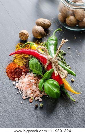 Spices, Chili, Himalaya Pink Salt, Nutmeg, Turmeric, Curry On Black Slate Background