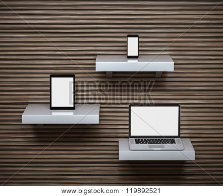 Responsive mockup of a laptop, digital tablet and smart phone on separate shelves. Clipping paths for all displays included.