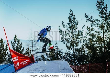 young athlete snowboarder jumping springboard