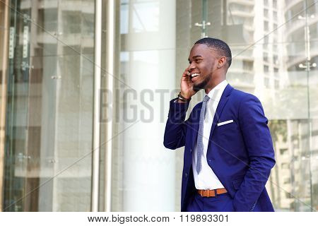 Happy African Businessman Talking On Cell Phone