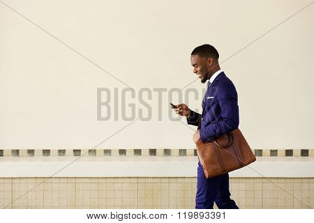 Young Man Sending Text Message On His Mobile Phone