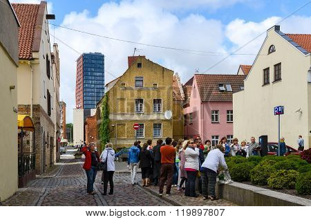 Tourists Are Visiting Attractions On Street Of Old Town, Klaipeda