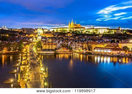 Pargue at dusk, view of the Lesser Bridge Tower of Charles Bridge (Karluv Most) and Prague Castle, Czech Republic.