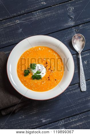 Healthy Quinoa Carrot Soup On Rustic Light Wooden Board. Delicious Vegetarian Food
