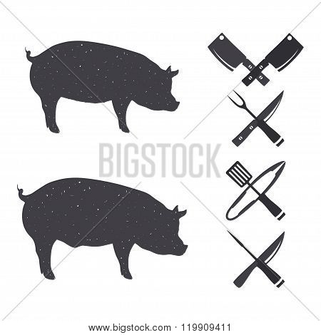 Black silhouettes of a pig and a hog.
