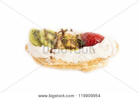 cream cake decorated with whipped cream and fruits