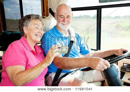 Senior couple using GPS to navigate their vacation motor home.