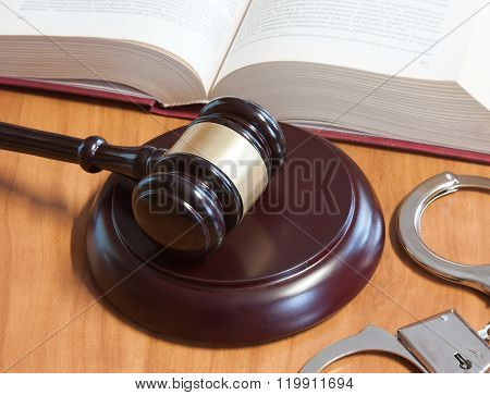 Judicial Hammer, Handcuffs And Codes Of Laws