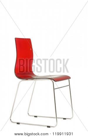 modern red plexiglass chair isolated on white