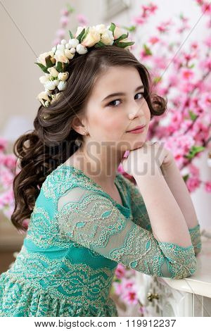 Portrait Of A Cute Little Girl In A Flower Wreath