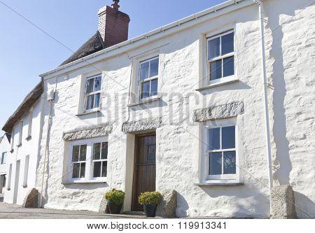 White cottage in english fishing seaside village in Cornwall