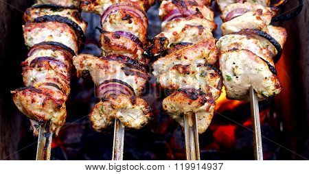 Grilled meat on skewers. Traditional Caucasus barbecue shashlik.