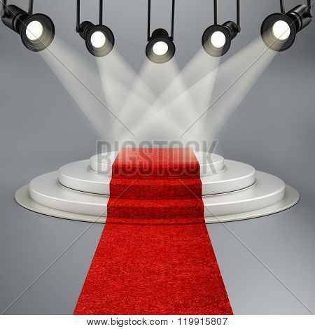 Red Carpet Leading To The Stage Illuminated By Spotlights