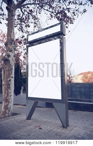 Photo blank lightbox on the bus stop. Vertical mockup