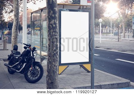 Photo blank lightbox on bus stop in the modern city. Authentic motobike parking close. Horizontal mo