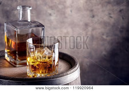 Glass and decanter of whiskey aged