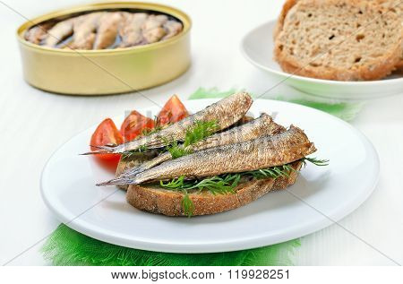 Sandwich With Sprats On White Plate