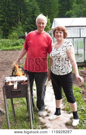 Elderly Domestic Pair Cook On Nature