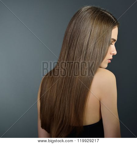 Hair. Beautiful brown-haired girl. Healthy long hair. Beauty. Beautiful woman. Hairstyle. Skincare. Female face.
