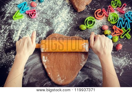 Woman's Hands Sheeting Dough With Rolling Pin