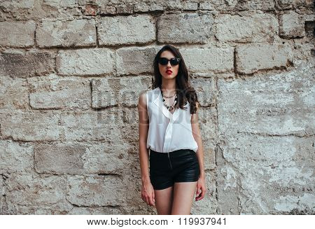 Attractive fashion woman in blouse and shorts