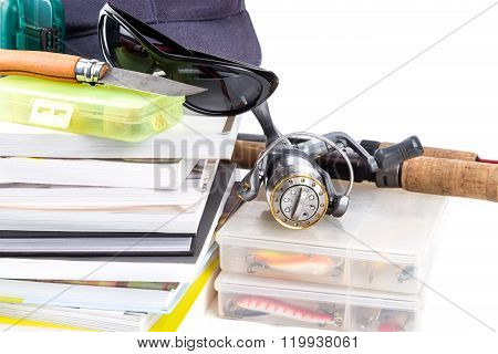 Fishing Tackles And Baits With Cat On Books
