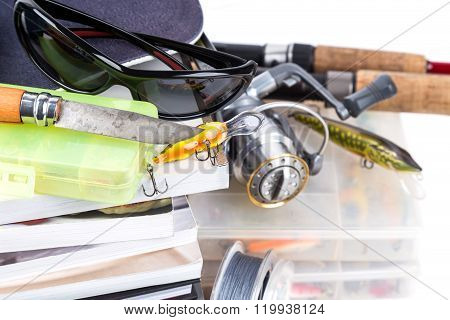 Fishing Tackles And Baits With Cap On Books