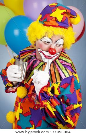 Alcoholic clown gets caught sneaking a drink from his flask.