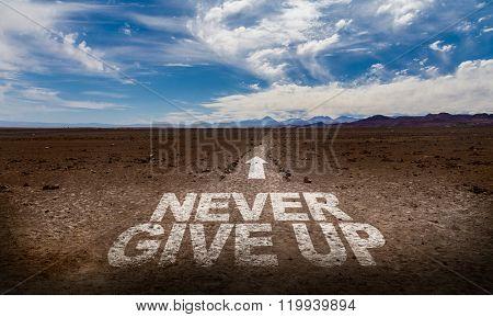 Never Give Up written on desert road
