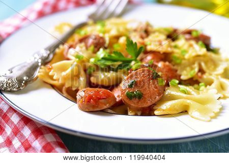 Farfalle With Sausage In Tomato Sauce.