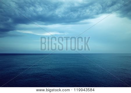 Dark Blue Sea And Stormy Clouds