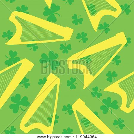 Seamless pattern with celtic harp and shamrock on green background
