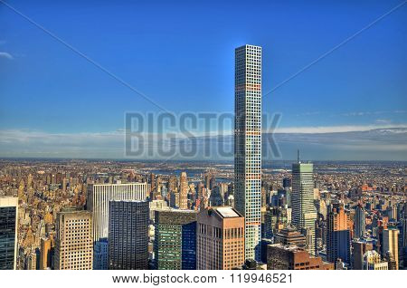 Colorful HDR image of midtown Manhattan New York City including the 432 Park Avenue building on a cl