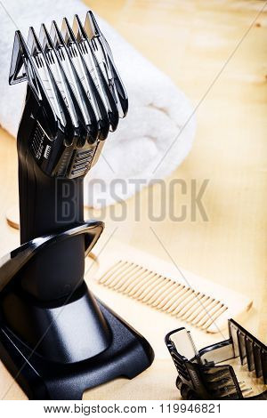 Setting With Hair Clipper And Wooden Comb