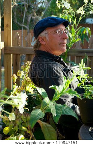 Man In Garden Looking Pleased