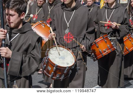 Brothers Playing Drums In The Procession