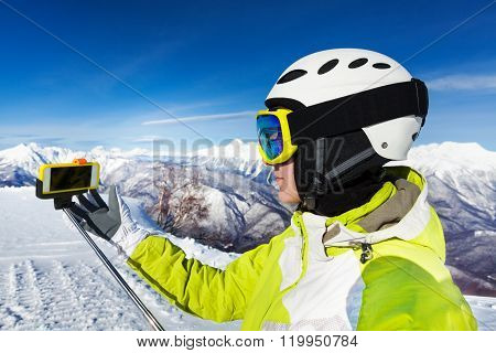 Woman with selfie stick on the mountain