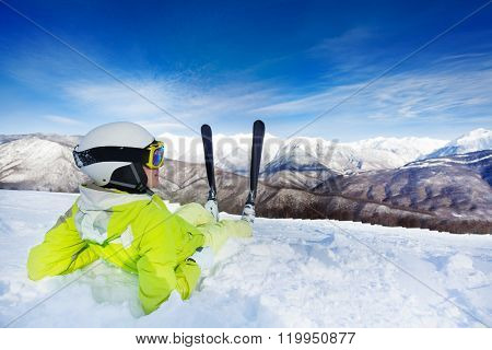 Skier rest in snow and enjoy mountain view