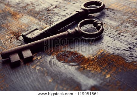 Old keys on blue scratched wooden background, copy space