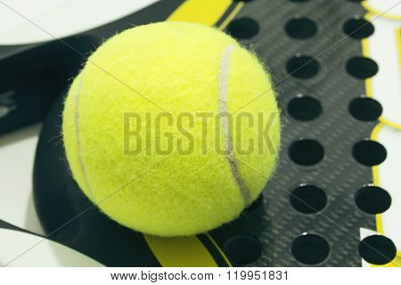 Paddle Ball On Racket. Yellow Paddle Ball Laying On Racket.