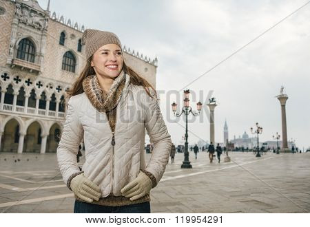 Woman Tourist Standing On St. Mark's Square Near Dogi Palace